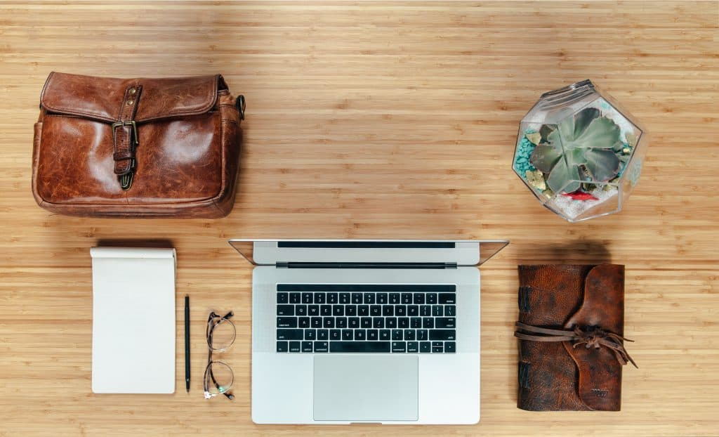 workspace-flatlay-with-leather-bag-and-notebook_4460x4460