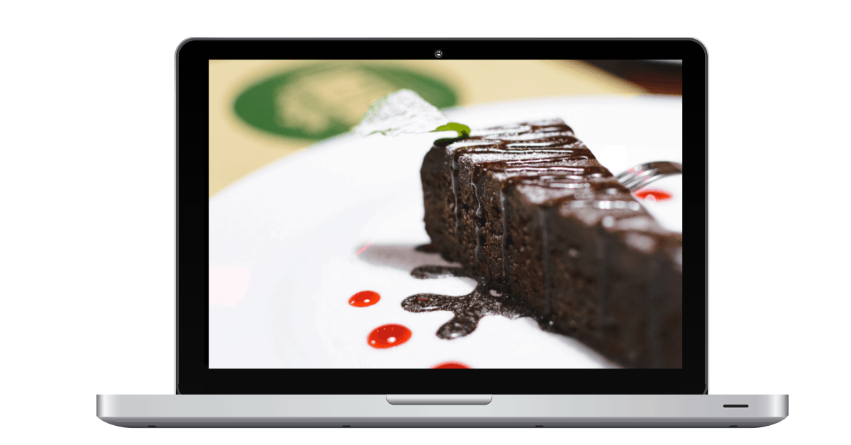 laptop with chocolate cake