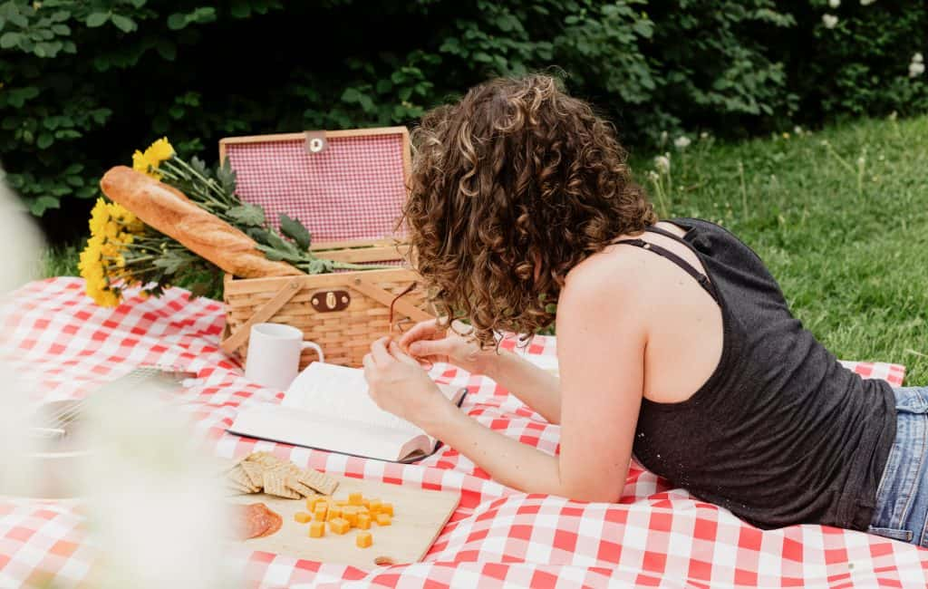 woman-reading-on-picnic-blanket