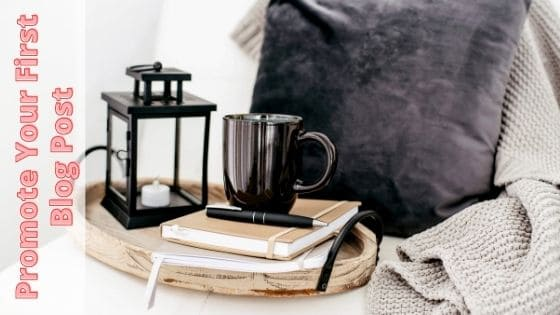 photo of coffee cup on notebook and a lamp on breakfast tray