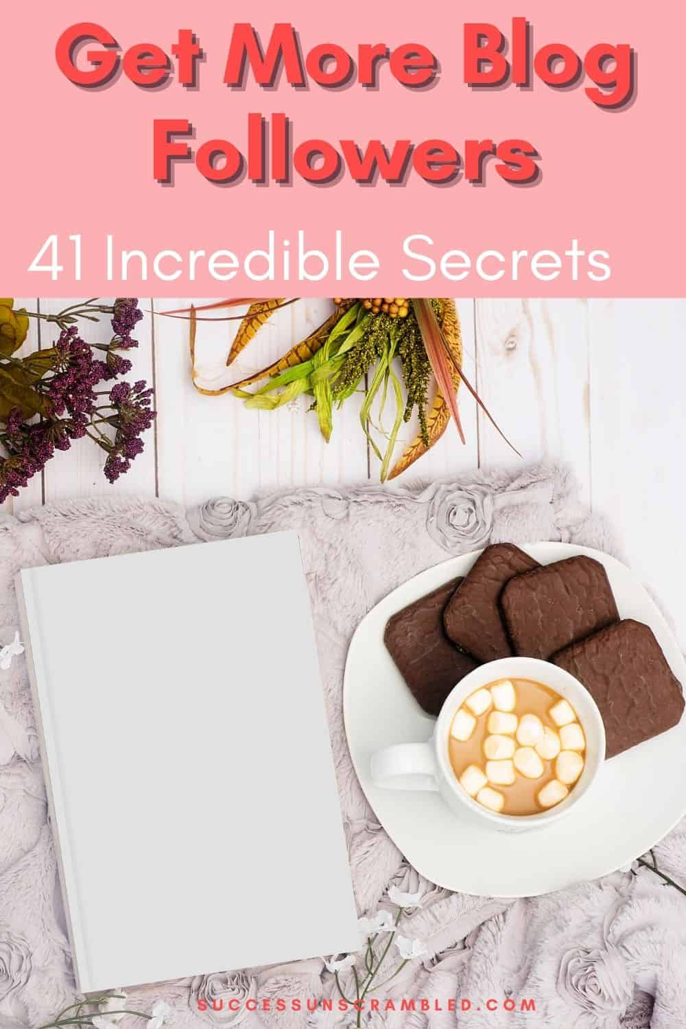 photo of a notebook next to a plate with chocolate biscuits and hot chocolate